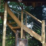 ground view of wooden treehouse staircase