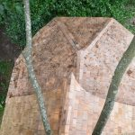 birdseye view of wooden treehouse cabin roof tiles