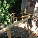 descending view of wooden treehouse staircase