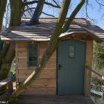 wooden treehouse platform cabin exterior