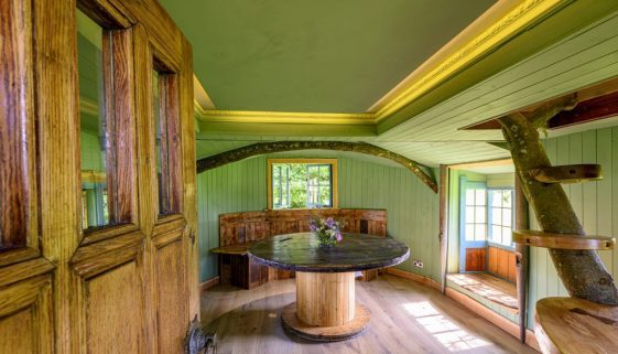 handmade wooden table and benches inside cabin